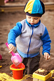 Boy Playing in Sandbox