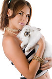 Beautiful young woman with rabbit