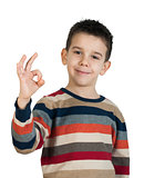 Child showing success symbol