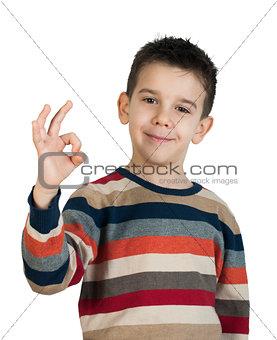 Child showing success symbol