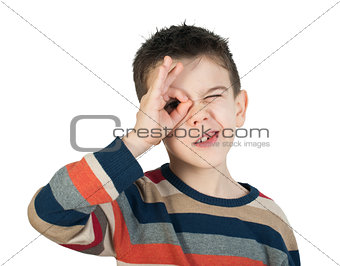 Child looking through his ​​hands