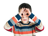 Child looking through his hands