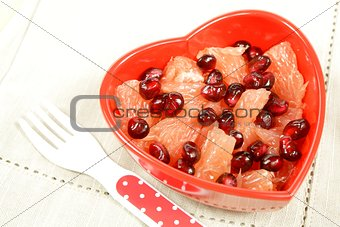 fruit salad in red heart