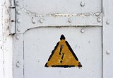 electrical hazard symbol on iron door