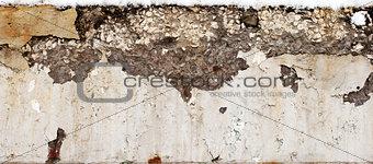large crack in the concrete beam