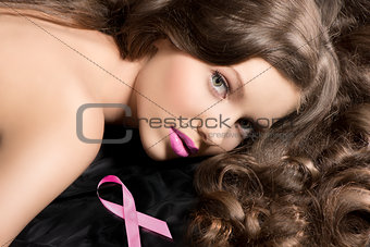 beauty portrait of lying girl with wavy hair