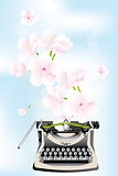 Spring creativity - typewriter with cherry blossoms on blue sky