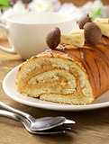 Sweet cake roll with coffee cream garnished with sweet mushrooms
