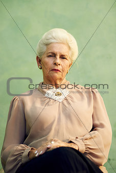 Portrait of serious old caucasian woman looking at camera
