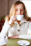Coffee. Beautiful girl drinking coffee. Cup of hot beverage