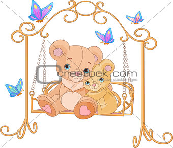Pair of bears on a swing