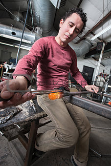Man Shaping Glass Art