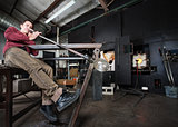 Worker Blowing Glass