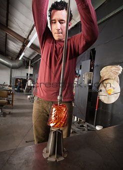 Artist Pulling Glass from Die