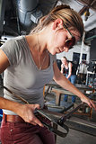 Sculptor Shaping Glass Art