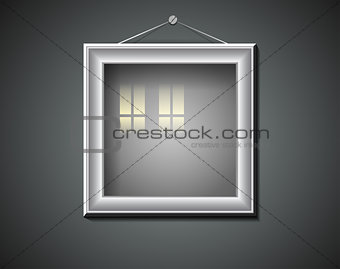 Blank picture frame with window reflection