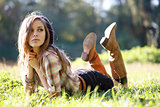 Beautiful Young Woman lying on grass