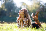 Beautiful Young Woman lying on grass with closed eyes
