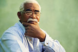 Portrait of serious african american old man looking at camera