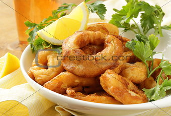 fried squid rings dipped in batter with lemon