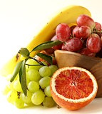 red and green grapes, bananas and oranges - tropical fruit