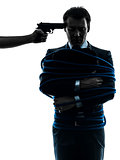 captive hostage business man silhouette