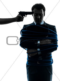 captive hostage business man silhouette