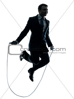 business man exercising jumping rope silhouette