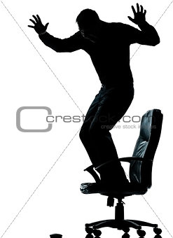 one business man afraid of computer mouse silhouette