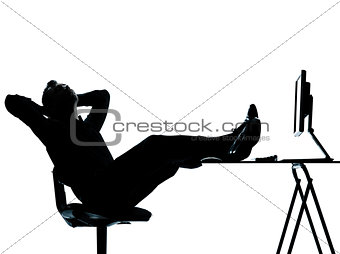 one business man computer computing relaxing silhouette