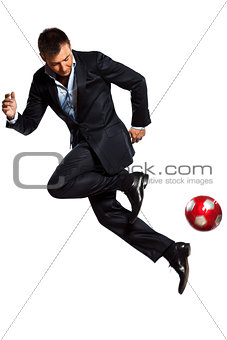 one business man playing juggling soccer ball
