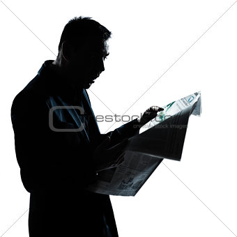 silhouette man portrait reading newspaper surprised