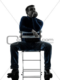 man sitting  thinking pensive silhouette full length