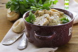 stew chicken in a creamy sauce with mushrooms