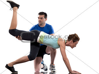 man aerobic trainer positioning woman  Workout