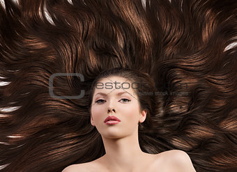 girl with long brown hair in front of the camera