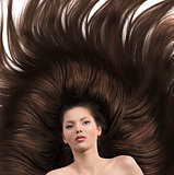 girl with long brown hair and nude shoulders