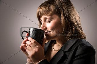 Business woman enjoy hot beverage