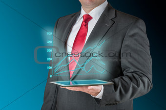 Business man with tablet und stock chart