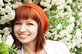 Portrait of a young beautiful girl in an orange knitted beret