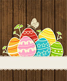 Wooden background with Easter eggs 