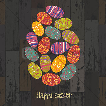 Easter eggs. Composed in one egg shape on wooden planks backgrou