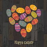 Easter eggs. Heart shaped on wooden planks background. Vector, E