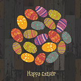 Easter eggs. Circle shaped on wooden planks background. Vector,