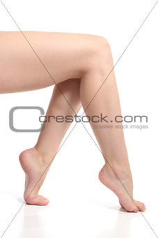 Beautiful naked legs of a woman sitting