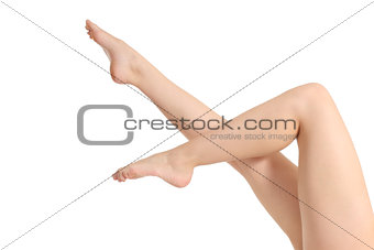 Beautiful naked woman legs pointing up