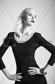 Studio fashion shot: beautiful girl in black dress. Black and white