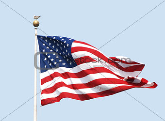 The American flag flies on a sunny day against a clear blue sky.