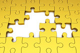 Gold puzzle pieces