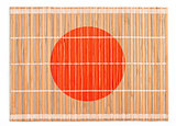 Bamboo placemat colored as Japanese flag isolated on white